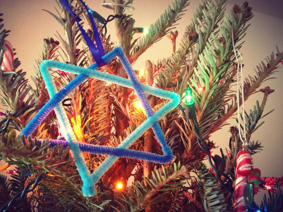 My contribution to my apartment's Christmas tree. I found this on what I'm almost certain is a crafts website for kids, but I still managed to decimate a few finger tips while trying to get the pipe cleaners to bend to my Jewish will.
