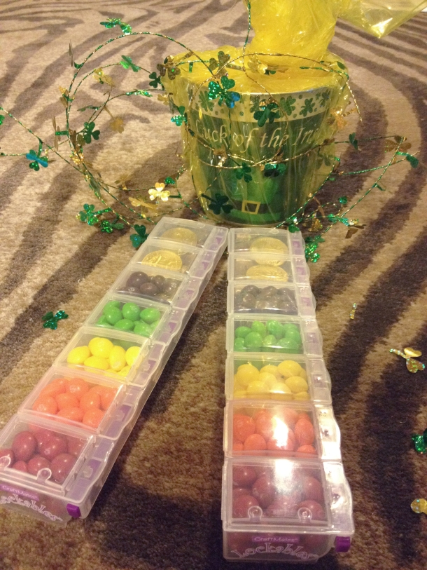 A double Skittle rainbow, leading to a pot of Hershey's gold nuggets, chocolate gold coins, and also some plastic gold coins that I really hope Jonathan bites into thinking are chocolate.